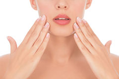 Part of woman face with hands stock photography