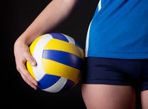 Part of woman's body with ball Royalty Free Stock Photography