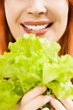 Part of a woman's face with salad Royalty Free Stock Photography