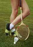 Part of woman who plays badminton. Foot of woman who plays badminton on grass Royalty Free Stock Photo