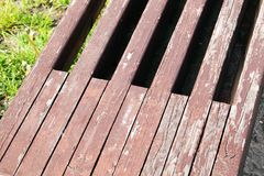 Part of a wooden bench. Painted in paint. Photo close-up in the park stock image