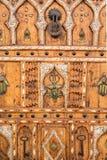 Part of Wooden door with a Black Iron Door Knocker in Essaouira, Morocco stock image