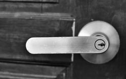 The part of wooden door with metal handle Royalty Free Stock Image