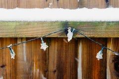 Snow on a fence stock photos