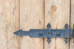 Part of wooden gate with forged hinges.  Stock Image