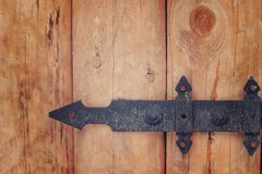 Part of wooden gate with forged hinges.  Royalty Free Stock Photography
