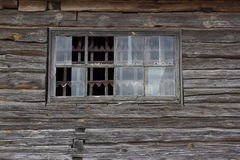 Part of the wooden wall  old house with broken windows and pine frame Stock Photos