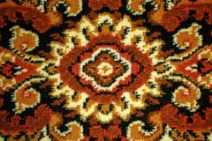 Part of wool carpet with patterns close-up. Background.  royalty free stock photo
