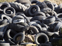 Part worn tires. Pile of used tires in the natural scenery Royalty Free Stock Photography