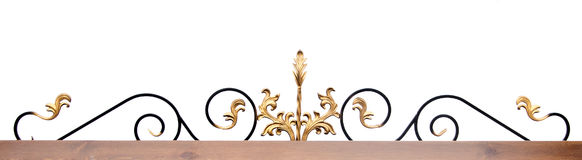Part of a wrought iron fence with blank wooden plank Royalty Free Stock Images