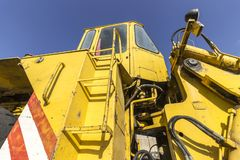 Big old bulldozer. Part of a yellow old bulldozer on a repair site royalty free stock images