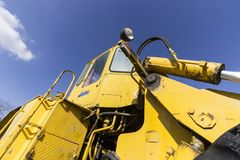 Big old bulldozer. Part of a yellow old bulldozer on a repair site royalty free stock image