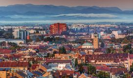 Zagreb at sunrise. Part of Zagreb roofs and mountain with clouds Royalty Free Stock Image
