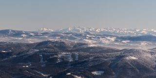 Part of Zapadne Tatry, whole Vysoke and Belianske Tatry from Lysa hora hill in winter Moravskoslezske Beskydy mountains in Czech royalty free stock photos