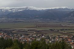 Part of the Zlatitsa Pirdop valley and residential district of  village Chavdar close in background of the snowy Balkan mountain. Sofia, Bulgaria, Europe stock images