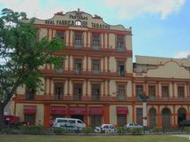 An authentic cigar factory in a street of la havana. Cuba urban lifestyle. 1845 partagas real fabrica de tabacos royalty free stock photography
