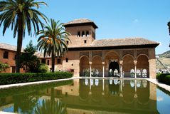 Partal gardens, Alhambra Palace. View of the Partal gardens with a pool and palm trees, Palace of Alhambra, Granada, Granada Province, Andalusia, Spain, Western Royalty Free Stock Images