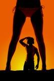 Parte anteriore e cowboy del bikini delle gambe della donna della siluetta Fotografie Stock Libere da Diritti