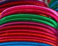 Parte da fotografia colorida do fundo dos braceletes Foto de Stock Royalty Free
