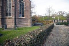 Parte da igreja velha e casa da quinta em holland Imagens de Stock
