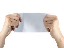 Parte da palavra do papel da terra arrendada da mão no branco Imagens de Stock Royalty Free