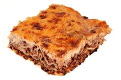 Parte das lasanhas com carne no fundo branco fotografia de stock royalty free