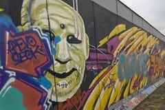 Parte de Berlin Wall com grafittis Imagens de Stock