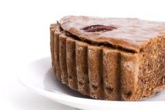 Parte de bolo de chocolate com porcas foto de stock royalty free