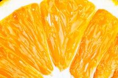 Parte de la macro anaranjada fresca del primer de la fruta Imagen de archivo libre de regalías