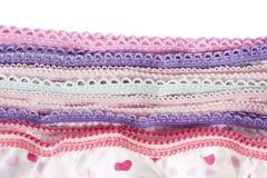 Parte de la pila de ropa interior hecha punto multicolora imagen de archivo