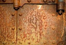 Parte de la puerta oxidada Foto de archivo libre de regalías