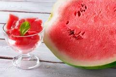 Parte de melancia em um copo Imagem de Stock