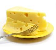 Parte de queijo na placa imagem de stock royalty free