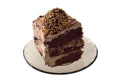 Parte de um bolo no saucer isolado no branco Imagens de Stock