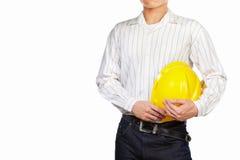 Parte del corpo dell'ingegnere civile con il casco di sicurezza Immagini Stock Libere da Diritti