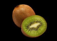 Parte del kiwi sul nero Fotografia Stock Libera da Diritti