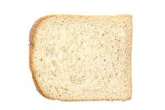 Parte del pane del pane tostato isolata su priorità bassa bianca Immagini Stock