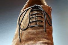 Parte del primer del zapato del marrón del mens. fotos de archivo libres de regalías
