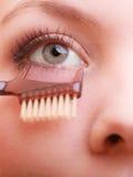 Parte del primo piano del dettaglio di trucco dell'occhio del fronte della donna Fotografia Stock