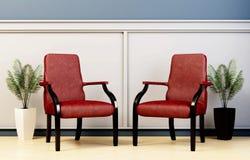 Parte dell'interno, di due sedie di cuoio e dei vasi con le piante Fotografie Stock Libere da Diritti