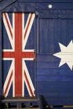 Parte della bandiera australiana su una capanna della spiaggia Fotografia Stock