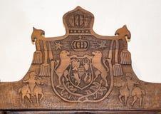 Parte della parte posteriore di una sedia con la bella scultura Immagini Stock