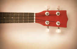 Parte delle ukulele rosse Fotografia Stock Libera da Diritti