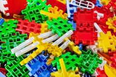 Parte di plastica del gioco dei bambini - fondo Fotografia Stock