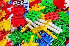 Parte di plastica del gioco dei bambini - fondo Immagine Stock