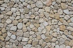 Parte di una parete di pietra, per fondo o struttura Fotografia Stock