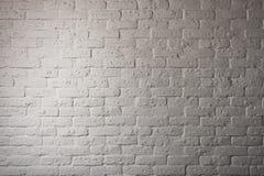 Parte di una parete di pietra del mattone con illuminazione Fotografie Stock