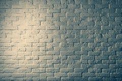 Parte di una parete di pietra del mattone con illuminazione Fotografia Stock