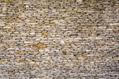 Parte di una parete di pietra, per fondo o struttura fotografia stock libera da diritti