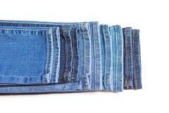 Parte do fundo da calças de ganga Isolado no branco fotos de stock